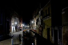Deserted Venetian canal at night