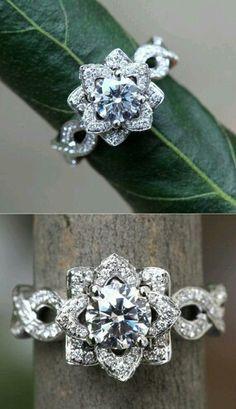 another flower engagement ring....i think i like the one with the petals more than this one