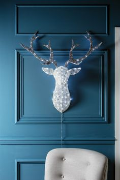 A pretty piece before lit, our stag head is spun with sparkly white acrylic strands and silver glittery antlers which are lined with bright white LEDs. Wherever you hang our glimmering stag, it's sure to spread Christmas sparkle!
