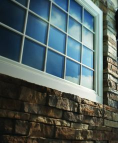 Andersen 400 Series Casement Picture Window, White Exterior, Permanent Exterior Grilles in Standard Colonial Pattern.
