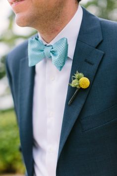 The dapper groom at a lakeside al fresco wedding in the Midwest: http://www.stylemepretty.com/2014/06/05/lakeside-al-fresco-wedding/ | Photography: www.mthreestudio.com