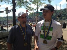 at the finish line of the 2012 Pittsburgh Marathon