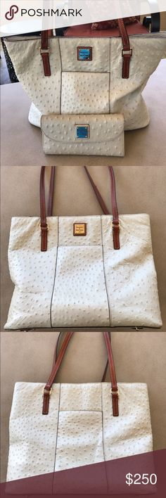 Dooney & Bourke Ostrich Handbag and Wallet  You will be ready for the summer with this gorgeous cream Dooney & Bourke Ostrich Handbag and Matching Purse.  This purse is so universal and will accompany any style without any thought.  It's a great go to for all occasions. Purchased at Dillard's and has been gently used. Dooney & Bourke Bags Shoulder Bags
