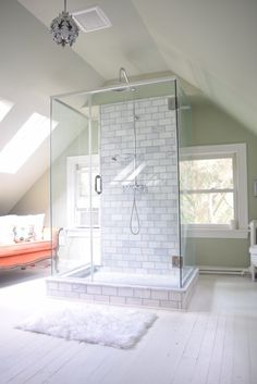 attic bathroom marble subway tile painted white wood floor bright white glass shower