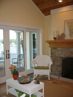 Painted paneled walls, wood fireplace, wood panel ceiling.. kitchen?