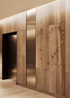 Idea for brass floor numbering in elevator bay. Not necessarily against wood grain, just the numbering