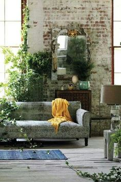 Love this living space. The painted brick wall is perfection!