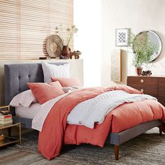 Grid-Tufted Upholstered Tapered Leg Bed  Positive feng shui: headboard, bed on feet, pink bedding.