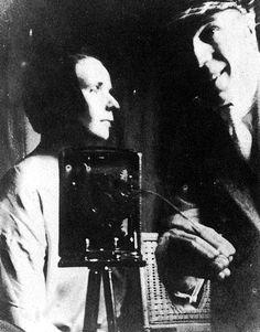 Nelly and Theo van Doesburg in the studio of Piet Mondrian in Paris. Spring 1921.