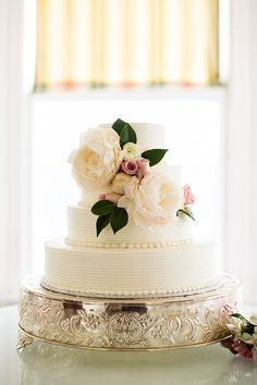 classic cake topped with peonies | Robyn Van Dyke #wedding