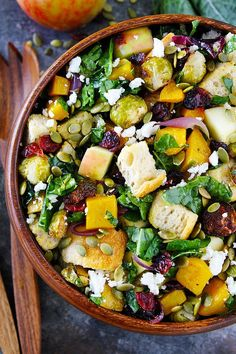 Fall Panzanella Salad-bread salad with butternut squash, brussels sprouts, apple, dried cranberries, pepitas, goat cheese, and kale. This easy fall salad is the perfect side dish for Thanksgiving! #Thanksgiving #salad