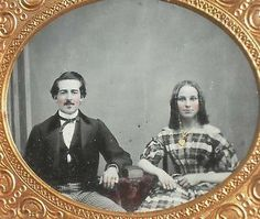 """A handsome couple from the 1850s who suffer from an overly enthusiastic application of blush to their cheeks. Still, she is very attractive, and he is quite dapper. The small smudge of hair under his lower lip is called a """"soul patch""""."""