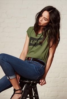 Go green. Pair a colorful graphic t-shirt with cuffed denim and black sandals for an easy, weekend outfit.