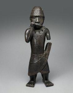 Figure of a Hornblower. Edo culture, ca. 1500-1550. Copper alloy.