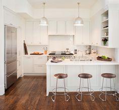 Gorgeous modern kitchen // white, wood, chrome accents, herringbone backsplash