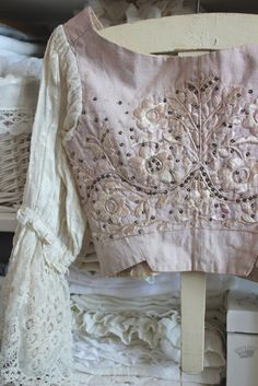 Wow. Embroidery and beading over lace. That's a lot of look.