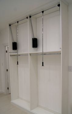 Pull Down Rod With Shelves Or Drawers Below.