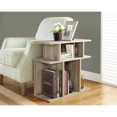 Enhance your living space with this beautifully crafted dark taupe, reclaimed wood-look side table. Featuring clean lines and 7 open concept display shelves, this modern unit is perfect for dressing up your living room and displaying your favorite decorative items.
