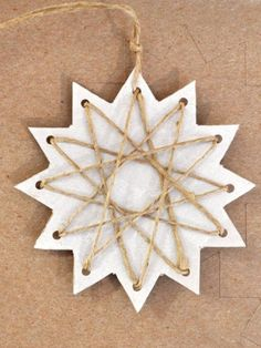 trim the tree – paper stars « home sweet homemadepaper star ornament with stringI've created a few new paper Christmas tree decorations this year and just now these cute and easy stars are my favorite! These are stars, but it's jusPaper and twine? Clay Christmas Decorations, Christmas Crafts For Kids, Homemade Christmas, Holiday Crafts, Christmas Ornaments, Homemade Ornaments, Christmas Ideas, Noel Christmas, Winter Christmas