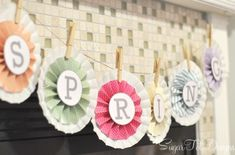 Cute spring banner using coffee filters, twine, clothes pins and the free printable. Could use the pattern and print my own letters to turn it into a Happy Easter banner :)