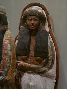 """More mummies, this time from the later days of the New Kingdom, from the reign of Ramses II, """"the Great."""" This is the coffin of a noble lady named Lineferti. Within her coffin is a second lid showing her in her very undead best clothes. Her extravagant jewelry and hair shows the opulence of late imperial Egypt under the reign of Ramses when Egypt was the dominant power in the ancient world."""