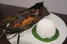Grilled Salmon With Thai Red Curry Sauce Wrapped In Banana Leaves. It's the perfect addition to your summer BBQ.