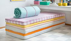 Bemz sells mattress covers- great for kids room stack four of them (plus have the three single beds)