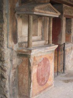 VI.16.7 Pompeii. May 2006. Room F, north portico. Lararium with aedicula over altar to household gods. See Boyce G. K., 1937. Corpus of the Lararia of Pompeii. Rome: MAAR 14, pp. 57-8, no. 221 and pl.38, 2.  See Giacobello, F., 2008. Larari Pompeiani: Iconografia e culto dei Lari in ambito domestico.  Milano: LED Edizioni. (p.277)