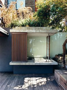 architect Brian Zulaikha's residence in Balmain Point, Australia / glass-and-wood outdoor bathhouse / outdoor shower