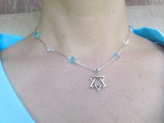 Silver Star of David- Swarovski Beads - IsraeliMade  This Star of David necklace is a very classy piece of jewelry. The star is made of silver. On the necklace are Swarovski Beads in colors of blue and transparent with silver bead as well (can make for you with other colors). It is a very gentle Star of David necklace yet very attractive to look at.   Made in Israel, Judaica, Jewish jewelry, Jewish art