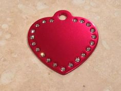 "Laser Engraved Swarovski Element Heart Pet ID Tag $15 ..... 15% off when you use coupon code ""Pinterest"""