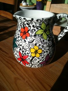 Pitcher with bold flowers and black stems/vines by Palee