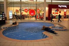 Optical illusion! Swimming Pool, Lodz, Poland, by artist Manfred Stader. His deep swimming pool was so realistic that shoppers swerve to avoid it!