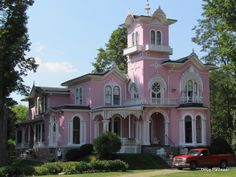Pink Italianate mansion in Wellsville, NY that even has a ghost story to tell. It remains in the same family that built it in 1868. Such amazing Victorian houses are all around this area. One has windows in the shape of keyholes