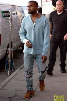 Kanye West rocking ripped blue denim, ocher moccasins and a light blue long sleeve