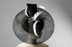 Philip Somerville Black and White Hat applied with woven horsehair brim, intersected with black and white plumes, 46cm, 18in diam