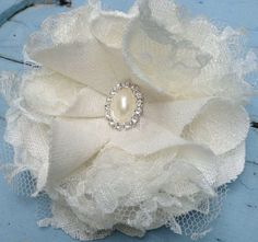 A personal favorite from my Etsy shop https://www.etsy.com/listing/578631054/ivory-linen-lace-bridal-hair-flower