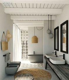 Love the use of natural fibres and simple black accessories in this bathroom.