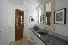 Short tiled-backsplash in bathroom with no tile on end walls| St-Barts