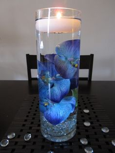 Blue orchids in water. Pretty centerpiece idea!