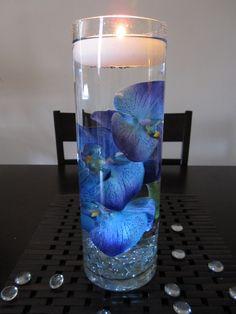 Blue orchids in water. Pretty centerpiece idea!