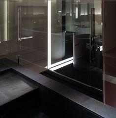 Black granite sculptural bath tub; Tokyo Towers Guest Room (by Curiosity.jp)