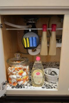 Great tips on how to create easy storage under the kitchen sink. Ideas for Organizing, only here on Bestlaminate's blog!