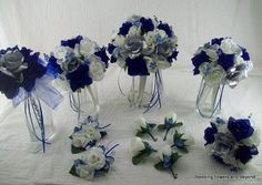 Ivory Royal Blue and Silver Bridal Bouquets Boutonnieres Rose Wedding Package made to order 12 Pieces Brides on a Budget Wedding Flowers CONGRATULATIONS on your up comming wedding! This was a custom order for a special bride. If you are interested in something like this please feel free to convo me with any requests you may have. WE LOVE CUSTOM ORDERS If you need more pieces or would like me to design this using different colors please feel free to convo me if you need something special or…