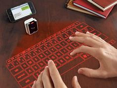 pretty cool  Laser Projection Virtual Keyboard - GetdatGadget