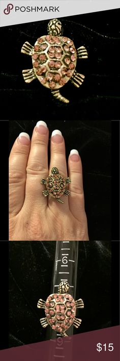 Cute Turtle Ring with Moving Head & Tail Cute Turtle Ring with Moving Head & Tail. Antiqued gold tone. Pretty crystals decorate its shell. Adjustable sizing, size 8. Jewelry Rings