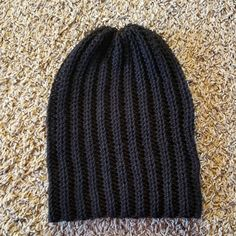 Classic Beanie Crochet Pattern This Black Beanie Crochet Pattern has a classic design, but is made a little differently than your typical crocheted hat. It's worked as a rectangle and then sewn into a hat. Crochet Slouchy Beanie Pattern, Mens Crochet Beanie, Beanie Pattern Free, Easy Crochet Hat, Crochet Gloves, Knit Crochet, Knit Hats, Crochet Scarves, Single Crochet