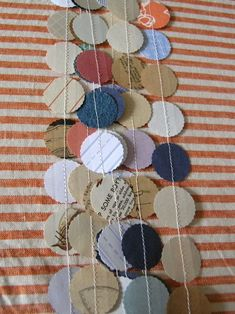 scrapbook paper garland....just use a punch with scraps, then sew them together!