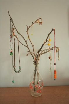 Tree branch jewelry stand - an inexpensive way to display your earrings and delicate necklaces/bracelets.