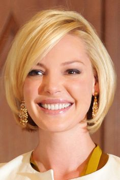 Katherine Heigel sports a classic bob w/ side swept bangs, especially good for round faces